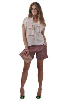 Zucca shirt, Sonia by Sonia Rykiel shorts, Red V alentino shoe and bag.