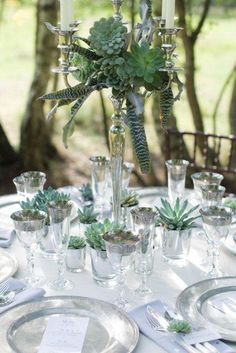 silver candelabra, succulents and tillandsia, would look great with some spanish moss hanging down too Flower Table Decorations, Garden Party Decorations, Wedding Decorations, Succulent Wedding Centerpieces, Succulent Arrangements, Beautiful Table Settings, Christmas Table Settings, Table Centers, Wedding Table
