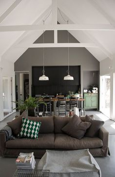 Luke's Melbourne, Australia home has pitched ceilings and support beams. The modern, white beams add charm to this country escape.