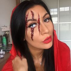 I created a 'Wolf got hold of Little Red Riding Hood and blinded her' type look. This is a great Halloween makeup look if you don't want to be that girl Cady from Mean Girls turned up as ha!