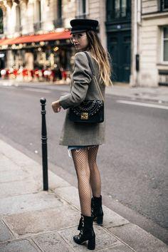 Fishnet-tights frayed-hem denim-skirt fiddler-cap oversized-blazer