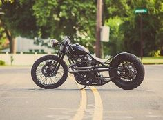 78 yamaha xs650 bobber | Here's an awesome bike with re-routed exhaust pipes, disk brakes on ...