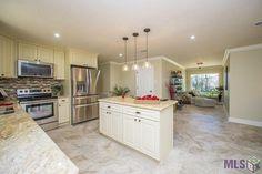 | Light Counters | White Cabinets | White Ceiling | Backsplash |