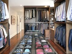 Contemporary Closet with Men's closet, Built-in display shelf, Custom closet storage, Built-in bookshelf, Hardwood floors