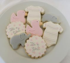 Baby shower cookie favors decorated for a girl in pink and gray: onesies, ducks, elephants and personalized rounds, 1 dozen on Etsy, $41.25