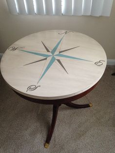 Compass Rose. Freebie table given a new lease on life! I sanded the finish off the top, primed and painted compass, applied dark glaze, and replaced missing gold claw feet.