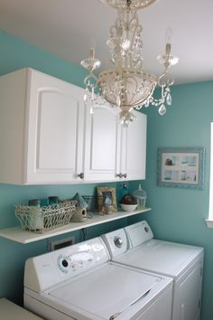love the colours, but i don't know if I'd put a chandelier in a laundry room?.. I do love the chandelier, but maybe in a different room