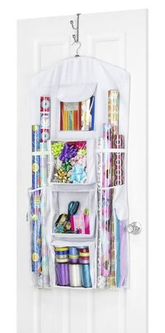 """Hanging Gift Wrap Organizer Dimensions: 23.25""""W x 0.1""""D x 46.75""""H Weight: 1.7…"""