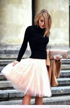 Light pink tutu skirt, black blouse and nude coat