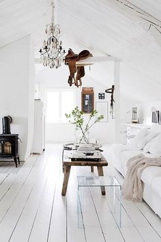 Texas chic, white + saddle + chandelier | via:.all-things-bright-