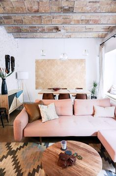 continental vibes | blush tufted modern sectional via sfgirlbybay | Navajo rug | stone tiled ceiling and white washed wall | get the look with an IKEA Söderhamn sofa with a pink Bemz cover