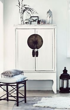 An example of scandinavian and asian pairing : white chinese style console | furniture + home decor