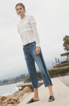 A dark-wash stripe highlights the wide-leg silhouette of these medium-indigo jeans finished with frayed step hems. When you buy Treasure & Bond, Nordstrom will donate 2.5% of net sales to organizations that work to empower youth.