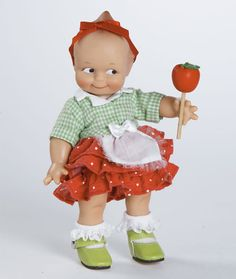 Candy Apple Kewpie Doll 8 inches tall Vinyl Kewpie Doll Kewpie® dolls are created with the same love, quality and attention to detail as the first Kewpie® dolls were in 1913. The doll that you will be