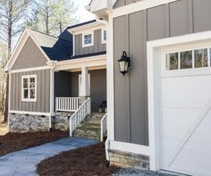 Image result for gray siding, stone, gray board and batten home exterior