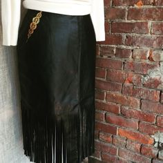 Fall obsession: fringe!  Black leather skirt with fringe hem and gold metallic detail at pockets. Size S, $159.  #blackleather #fringe #restyledvintage #leatherskirt #designeroriginal #recycled #KingstonNY #sustainablestyle