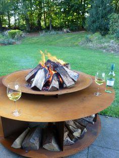 Corten steel fireplace / BBQ / fire pit and loungetable combined to enjoy a nice summer evening even more. / Cortenstalen vuurplaats / BBQ en loungetafel om een mooie zomeravond nog meer te waarderen.