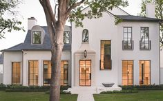 It's a nerve-wracking experience to choose your exterior paint color. After all, this is a color you have to live with for a good long time. Selecting the most appropriate color for your house's exterior is dependent upon a great… Continue Reading → White Exterior Houses, Stucco Exterior, Stucco Homes, Modern Farmhouse Exterior, Exterior Paint, Exterior Design, Exterior Colors, White Stucco House, Stucco Siding