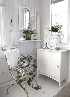 Cool rusty chair, love that mirror, and great urn!---Jeanne d'Arc Living…
