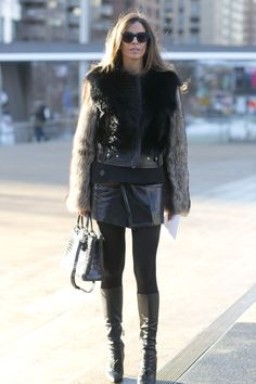 Between the furry topper and leather skirt, this attendee was all about an edgy-girl vibe.  #NYFW
