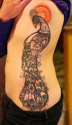 This fantastic tattoo was inked by David Hale. #InkedMagazine #peacock #tattoo #tattoos #inked #ink