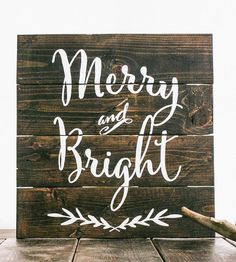 "Deck the halls this holiday season with this handcrafted wood sign, which reads, ""Merry and Bright."""