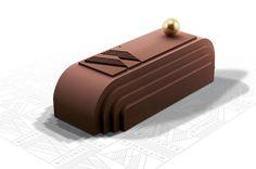 Bûche La Magnifique - Wittamer - Design Kate Houben - A la rigueur d'une géométrie s'allient la sobriété des formes, la couleur d'une saveur et la sensualité d'une perle d'or. Dacquoise aux noisettes, mousse au caramel pimentée légèrement de fleur de sel de Guérande et mousse au chocolat noir Grand Cru Wittamer. 55 € pour 6 personnes.