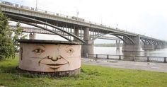The Living Wall: Russian street artist Nikita Nomerz turns derelict buildings into faces Riverman in Novosibirsk  Riverman in Novosibirsk Picture: Nikita Nomerz / Rex Features