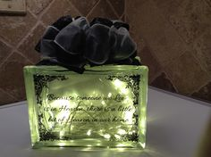 """SPECIAL ORDER """"BECAUSE SOMEONE WE LOVE IS IN HEAVEN, THERE IS A LITTLE BIT OF HEAVEN IN OUR HOME"""" WITH BLACK/WHITE RIBBON EMBELLISHMENT AND WARM LED BATTERY OPERATED LIGHTS. LASER ETCHING BY LAVENE & CO."""