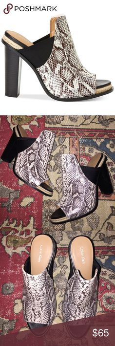 Calvin Klein Snakeskin Print Open-Toe Mules Like new condition, maybe worn once- no flaws • 4 1/4 in heel • pretty true to size. Calvin Klein Shoes Mules & Clogs