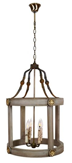 I just bought 2 of these chandeliers to put over my kitchen Island!  I found these while shopping at High Point Market this year!