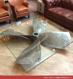 Propeller glass table