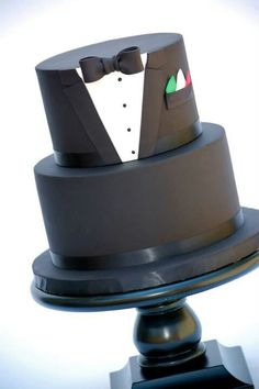 Groom's Cake; little hankie in the pocket could coordinate with wedding colors. Love this cake. So classic.