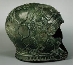 Helmet. Greek, Cretan, late 7th Century BC,Bronze.  A modification of the Corinthian type helmet. These highly decorated helmets were often dedicated in Cretan sanctuaries.