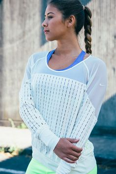 All white. Ultra light. Perfect for layering. The Nike Lattice and Sheer Training Shirt.