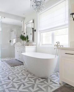 We are in love with this beautiful master bathroom designed by South Harlow Interiors And of course we are happy to see our Talya Water Jet Collection beautifying the floor 🙂. White Blinds, White Marble Bathrooms, Shower Tile Designs, Bathroom Designs, Herringbone Wall, Shower Surround, Bathroom Inspiration, Bathroom Ideas, Bathroom Trends