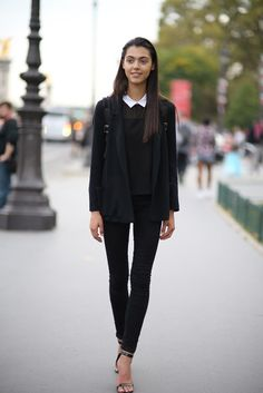 All black with little white collar. | Street Style | via vogue.it