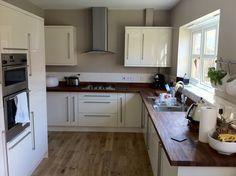 cream kitchen with butcher block work top and grey or mocha tiles Kitchen Worktop, Kitchen Flooring, Kitchen Cabinets, Oak Flooring, Oak Cabinets, Smart Kitchen, New Kitchen, Kitchen Decor, Kitchen Ideas