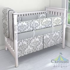 Crib bedding in Gray Traditions Damask, Silver Gray Minky. Created using the Nursery Designer® by Carousel Designs where you mix and match from hundreds of fabrics to create your own unique baby bedding. #carouseldesigns