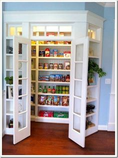 Pantry surrounded by shelving instead of plain walls...pretty smart! And I loooooove that wall color. Someday, someday that will be in my home.