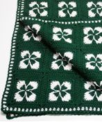 This Crochet Shamrock Afghan will have your Irish eyes smiling before you're through. The easy crochet afghan pattern is great for beginning crocheters who want to get in the holiday spirit.