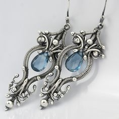 These earrings are an engineering marvel.  This artist must have a good understanding of the architecture required to support this design.  Very nice!