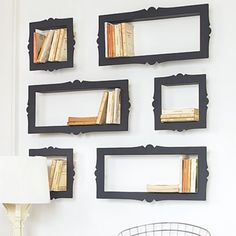 Book storage. Doesn't take up any floor space, really cute. Shadow boxes with frames nailed over them. (White, yellow, light blue frames?)