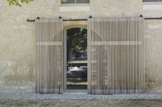 Sliding slatted door