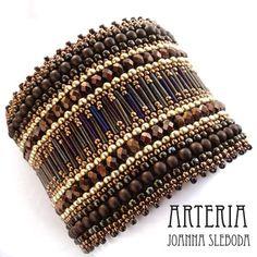 Arteria: Golden Brown bangle  #beadwork  Peyote, I think, or maybe brick, built horizontally.