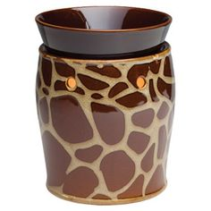 Rich, brown giraffe spots and contrasting white accents create an exotically organic patchwork. #giraffe #scentsy