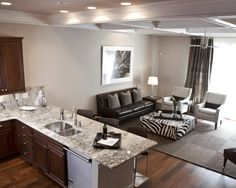 Like the gray walls and flooring, with dark cabinets. Just with a traditional spin.