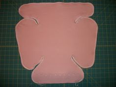 Here are a few sizes cut out and laid over each other. Here is the Medium with the edges serged and the first elastic guide seam...