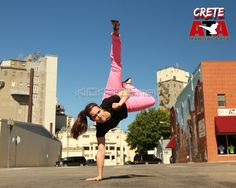 kickpics crete nebraska creteata taekwondo tkd martialarts karate woman girl women female kick kicking sky summer street road