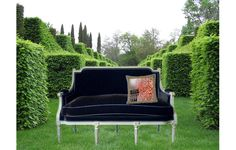 Plensa Vendome Figure MImages on Neoclassical sofa in the garden
